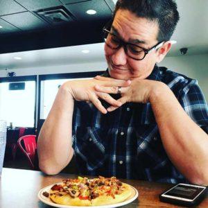 Louie Foxx eating pizza